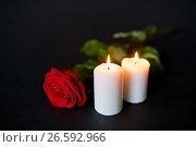 Купить «red rose and burning candles over black background», фото № 26592966, снято 20 марта 2017 г. (c) Syda Productions / Фотобанк Лори