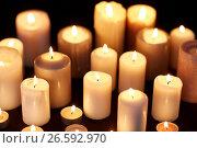 Купить «candles burning in darkness over black background», фото № 26592970, снято 20 марта 2017 г. (c) Syda Productions / Фотобанк Лори