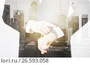 Купить «close up of businessman with wristwatch», фото № 26593058, снято 21 марта 2013 г. (c) Syda Productions / Фотобанк Лори