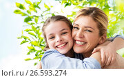 happy family of girl and mother hugging. Стоковое фото, фотограф Syda Productions / Фотобанк Лори