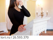 Купить «woman with wipe crying at funeral in church», фото № 26593370, снято 20 марта 2017 г. (c) Syda Productions / Фотобанк Лори