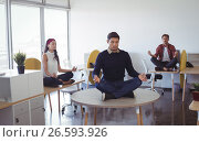 Купить «Business colleagues practicing yoga at office», фото № 26593926, снято 4 марта 2017 г. (c) Wavebreak Media / Фотобанк Лори