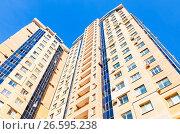 Купить «New tall apartment building against blue sky background», фото № 26595238, снято 27 апреля 2016 г. (c) FotograFF / Фотобанк Лори