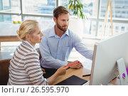Купить «Attentive executives working over personal computer at desk», фото № 26595970, снято 5 марта 2017 г. (c) Wavebreak Media / Фотобанк Лори