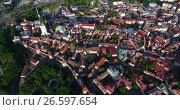 Купить «Башня Олафа в средневековой части города, вид сверху на улицы и крыши домов. Таллин, Эстония», видеоролик № 26597654, снято 29 июня 2017 г. (c) Кекяляйнен Андрей / Фотобанк Лори
