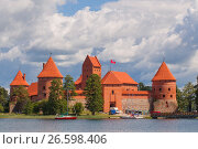 Купить «TRAKAI, LITHUANIA - JUNE 21, 2017 - medieval Trakai castle built on an island of Lake Galve, near Vilnius. One of the most popular touristic destinations in Lithuania.», фото № 26598406, снято 21 июня 2017 г. (c) Майя Крученкова / Фотобанк Лори