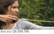 Купить «Woman shoots an arrow and satisfied of result», видеоролик № 26599790, снято 21 июня 2017 г. (c) Илья Шаматура / Фотобанк Лори
