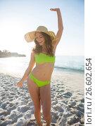 Купить «Happy young woman wearing green bikini while dancing at beach», фото № 26602654, снято 17 января 2017 г. (c) Wavebreak Media / Фотобанк Лори