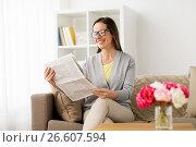 Купить «happy woman reading newspaper at home», фото № 26607594, снято 22 апреля 2017 г. (c) Syda Productions / Фотобанк Лори