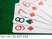Купить «poker hand of playing cards on green casino cloth», фото № 26607654, снято 15 марта 2017 г. (c) Syda Productions / Фотобанк Лори
