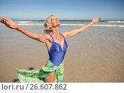 Купить «Happy senior woman with arms outstretched standing on shore», фото № 26607862, снято 1 марта 2017 г. (c) Wavebreak Media / Фотобанк Лори
