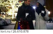 Купить «Couple interacting while having coffee at night», видеоролик № 26610878, снято 9 апреля 2020 г. (c) Wavebreak Media / Фотобанк Лори