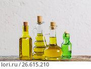 Купить «Olive oil on the wooden table», фото № 26615210, снято 23 мая 2017 г. (c) Майя Крученкова / Фотобанк Лори