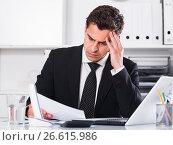 Купить «Frustrated businessman at office desk», фото № 26615986, снято 20 апреля 2017 г. (c) Яков Филимонов / Фотобанк Лори