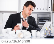 Купить «Businessman feeling thirsty in hot office», фото № 26615998, снято 20 апреля 2017 г. (c) Яков Филимонов / Фотобанк Лори