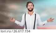 Купить «Millennial man meditating against blurry blue brown background», фото № 26617154, снято 19 марта 2019 г. (c) Wavebreak Media / Фотобанк Лори