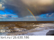 Купить «Rainbow off Weybourne Norfolk in rain storm.», фото № 26630186, снято 4 января 2017 г. (c) age Fotostock / Фотобанк Лори