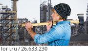 Купить «Side view of male hipster holding axe against factory», фото № 26633230, снято 17 июля 2018 г. (c) Wavebreak Media / Фотобанк Лори