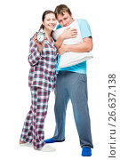 Young couple in pajamas with pillow and alarm clock on white background posing. Стоковое фото, фотограф Константин Лабунский / Фотобанк Лори