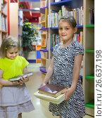 Купить «Two pretty girls with books in library.», фото № 26637198, снято 21 ноября 2019 г. (c) Дарья Филимонова / Фотобанк Лори
