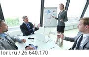 Купить «Business team at presentation», видеоролик № 26640170, снято 8 июля 2017 г. (c) Иван Михайлов / Фотобанк Лори