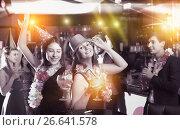 Купить «Portrait of active women and men in caps with cocktails», фото № 26641578, снято 20 апреля 2017 г. (c) Яков Филимонов / Фотобанк Лори