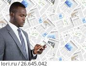 Купить «Business man looking at phone against document backdrop», фото № 26645042, снято 18 января 2019 г. (c) Wavebreak Media / Фотобанк Лори