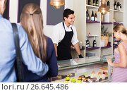 Купить «Two female with one male are choosing delicious cakes from showcase», фото № 26645486, снято 5 июня 2017 г. (c) Яков Филимонов / Фотобанк Лори