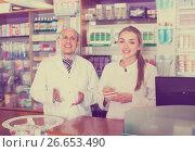 Купить «Portrait of two pharmacists working in farmacy», фото № 26653490, снято 22 ноября 2019 г. (c) Яков Филимонов / Фотобанк Лори