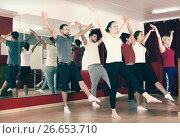 Купить «Males and females dancing», фото № 26653710, снято 17 ноября 2018 г. (c) Яков Филимонов / Фотобанк Лори