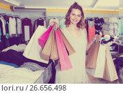 Купить «Customer female is holding purchases», фото № 26656498, снято 19 июня 2017 г. (c) Яков Филимонов / Фотобанк Лори