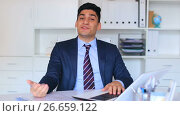 Купить «Smiling manager working efficiently at office desk with laptop», видеоролик № 26659122, снято 26 июня 2017 г. (c) Яков Филимонов / Фотобанк Лори