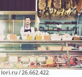 Купить «Seller offering displayed sorts of meat», фото № 26662422, снято 2 января 2017 г. (c) Яков Филимонов / Фотобанк Лори