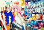 Happy family trying on helmet with horns in festive store, фото № 26668966, снято 11 апреля 2017 г. (c) Яков Филимонов / Фотобанк Лори