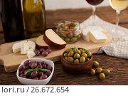 Купить «Close up of olives with cheeses and vegetable by wineglass», фото № 26672654, снято 15 февраля 2017 г. (c) Wavebreak Media / Фотобанк Лори