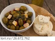 Купить «High angle view of olives with cheese on wax paper», фото № 26672762, снято 15 февраля 2017 г. (c) Wavebreak Media / Фотобанк Лори