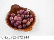 Купить «Marinated olives in bowl», фото № 26672914, снято 15 февраля 2017 г. (c) Wavebreak Media / Фотобанк Лори