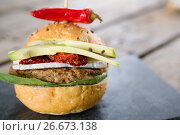 Купить «Close up burger with jalapeno pepper and vegetables», фото № 26673138, снято 13 января 2017 г. (c) Wavebreak Media / Фотобанк Лори