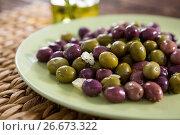 Купить «Marinated olives in plate», фото № 26673322, снято 15 февраля 2017 г. (c) Wavebreak Media / Фотобанк Лори