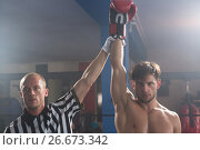 Купить «Referee holding hand of winning young male boxer», фото № 26673342, снято 22 января 2017 г. (c) Wavebreak Media / Фотобанк Лори