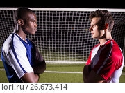 Купить «Side view of young male soccer players looking at each other», фото № 26673414, снято 25 января 2017 г. (c) Wavebreak Media / Фотобанк Лори