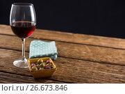Купить «Close-up of marinated olives with glass of wine», фото № 26673846, снято 15 февраля 2017 г. (c) Wavebreak Media / Фотобанк Лори