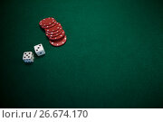 Купить «Pair of dice and casino chips on poker table», фото № 26674170, снято 6 апреля 2017 г. (c) Wavebreak Media / Фотобанк Лори