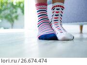 Купить «Low section of girl wearing different socks», фото № 26674474, снято 26 января 2017 г. (c) Wavebreak Media / Фотобанк Лори