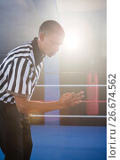 Купить «Young male referee gesturing in boxing ring», фото № 26674562, снято 22 января 2017 г. (c) Wavebreak Media / Фотобанк Лори