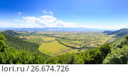 Купить «Panoramic view of the Alazani valley from the height of the hill. Kakheti region», фото № 26674726, снято 21 марта 2019 г. (c) Mikhail Starodubov / Фотобанк Лори
