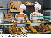Купить «Female cooks demonstrating and selling pastry in the cafe», фото № 26676062, снято 21 июня 2019 г. (c) Яков Филимонов / Фотобанк Лори