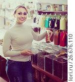 Купить «Woman choosing tea sold by weight in shop», фото № 26676110, снято 22 октября 2018 г. (c) Яков Филимонов / Фотобанк Лори