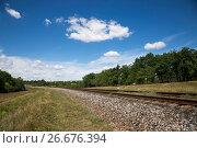 Купить «Летний пейзаж с железной дорогой и дубовой рощей», фото № 26676394, снято 8 июля 2017 г. (c) V.Ivantsov / Фотобанк Лори