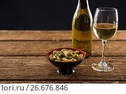 Купить «Close-up of marinated olives with glass of wine», фото № 26676846, снято 15 февраля 2017 г. (c) Wavebreak Media / Фотобанк Лори